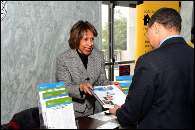 Community Development Specialist Denise Murray promotes the OCC's Helpwithmybank.gov Question and Answer booklet as a resource for financial concerns.
